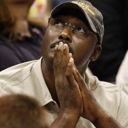 Former Jazz great Karl Malone watches the game as the Utah Jazz and the Phoenix Suns play NBA basketball Wednesday, April 4, 2012, in Salt Lake City, Utah.