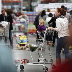 Customers shop at the world's largest Costco, 1818 S. 300 West, in Salt Lake City on Friday, Oct. 30, 2015.