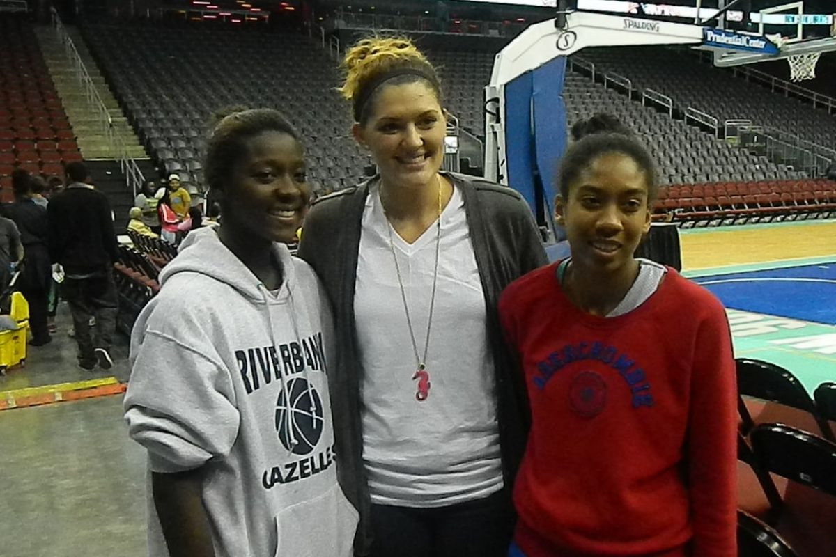 UConn's Stefanie Dolson with two NY Gazelle eighth graders at Friday's New York Liberty game.