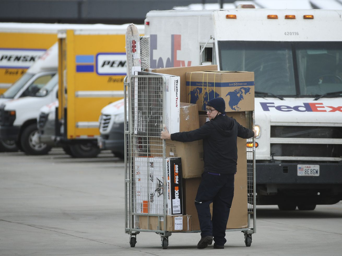 FedEx trucks are loaded for deliveries in Salt Lake City on Tuesday, Nov. 10, 2020. Ongoing and widespread COVID-19 restrictions are fueling an unprecedented volume of online shopping for the holiday season.