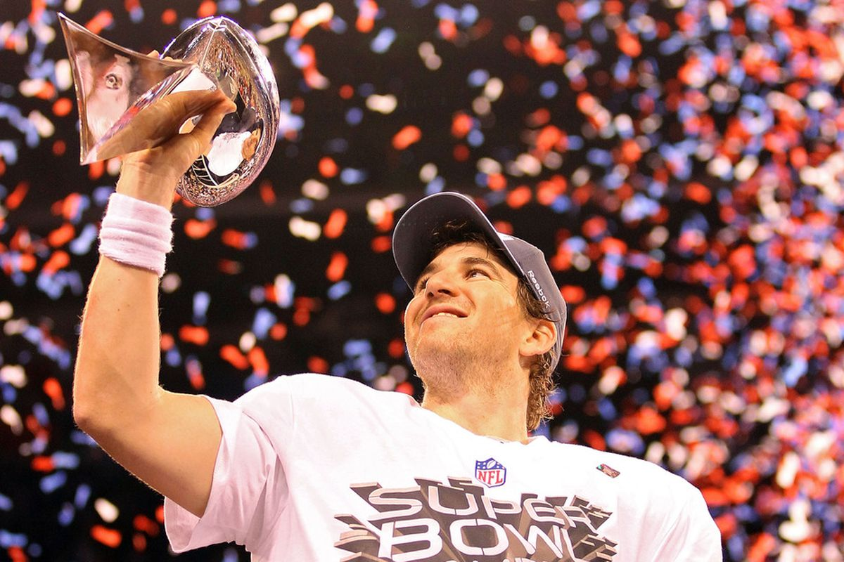 Eli Manning and the new York Giants earned the 2012 Lombardi Trophy. Who will earn it this time around? (Photo by Ezra Shaw/Getty Images)