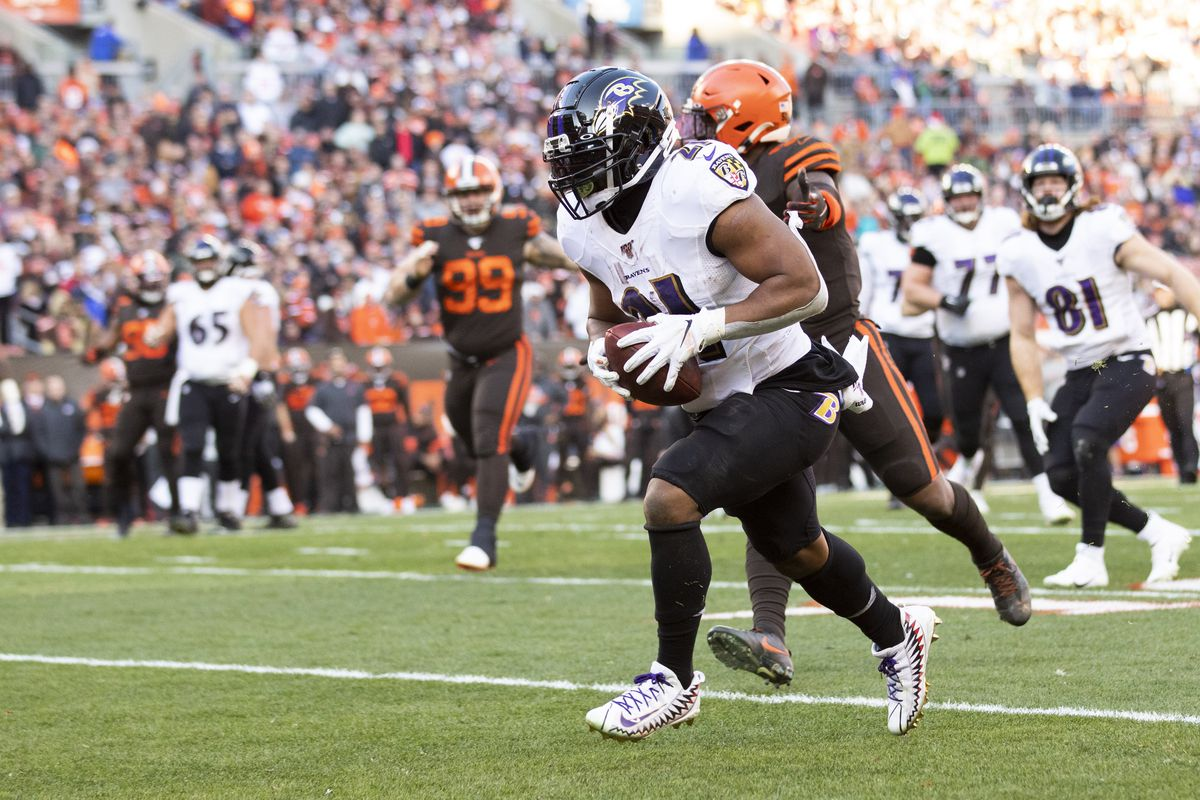 Baltimore Ravens running back Mark Ingram runs the ball into the end zone for a touchdown against the Cleveland Browns during the third quarter at FirstEnergy Stadium.