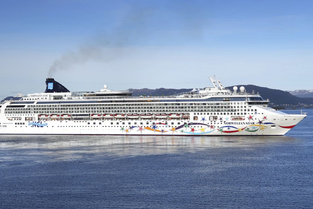 """FILE - May 19, 2016 file photo of the cruise ship """"Norwegian Star"""" outside of Aalesund, Norway. A British woman, identified as Kay from England, was rescued Sunday Aug. 19, 2018 after falling from the Norwegian Star cruise ship and spending 10 hours in th"""