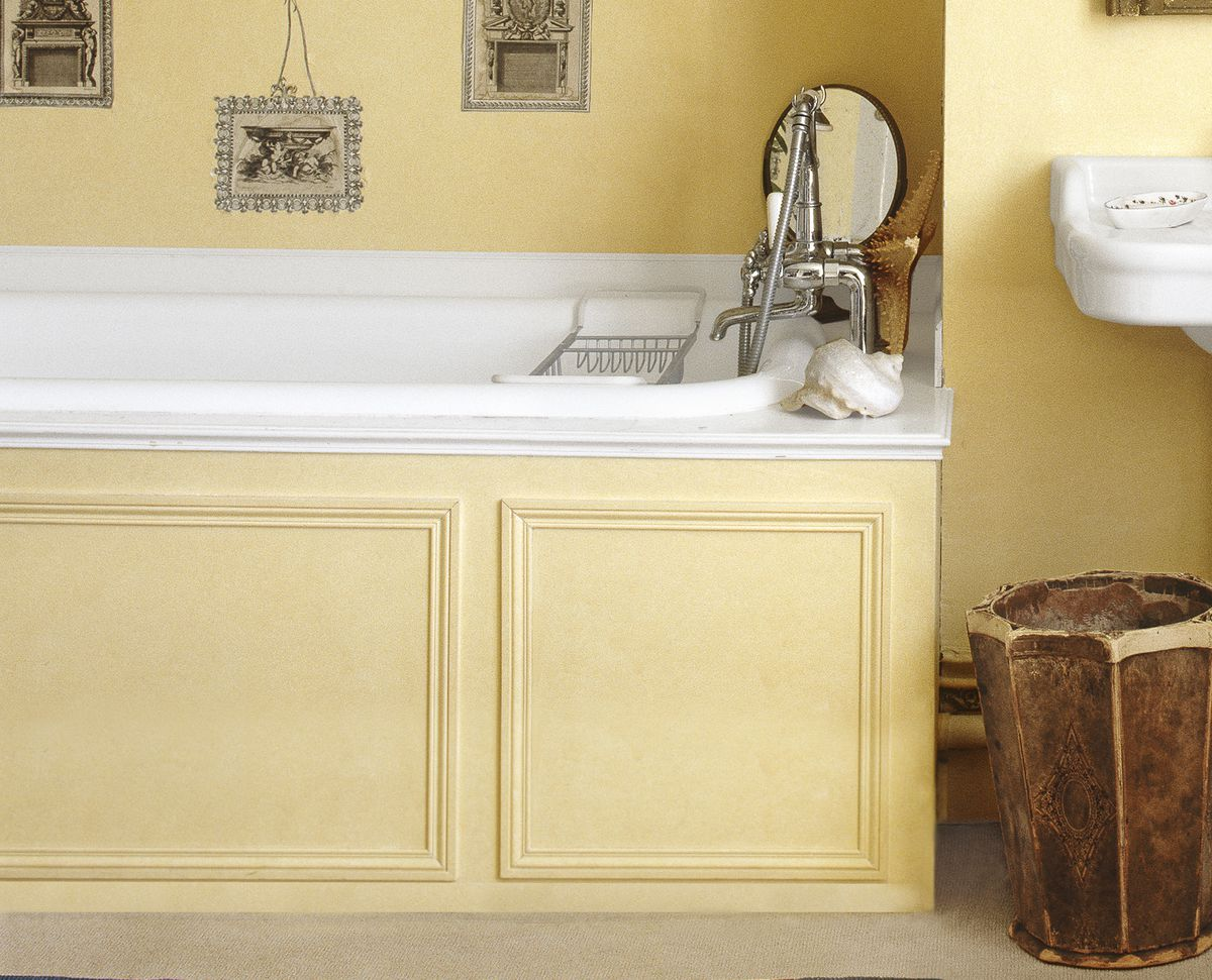 Yellow vintage tub with newly updated tub surround.
