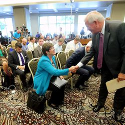 LDS Church Historian and Recorder Elder Steven E. Snow, shakes hands with President Robin Linkhart of the Community of of Christ's presidency of the Seventy, after the press conference, as the LDS Church, in cooperation with the Church of Christ announced the release of the printers manuscript of the the Book of Mormon, during a press conference Tuesday, Aug. 4, 2015, at the LDS Church's History library in Salt Lake City.