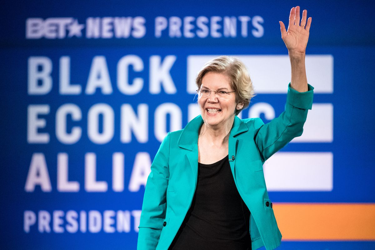 Sen. Elizabeth Warren (D-MA) waves to the audience during the Black Economic Alliance Forum in Charleston, South Carolina.