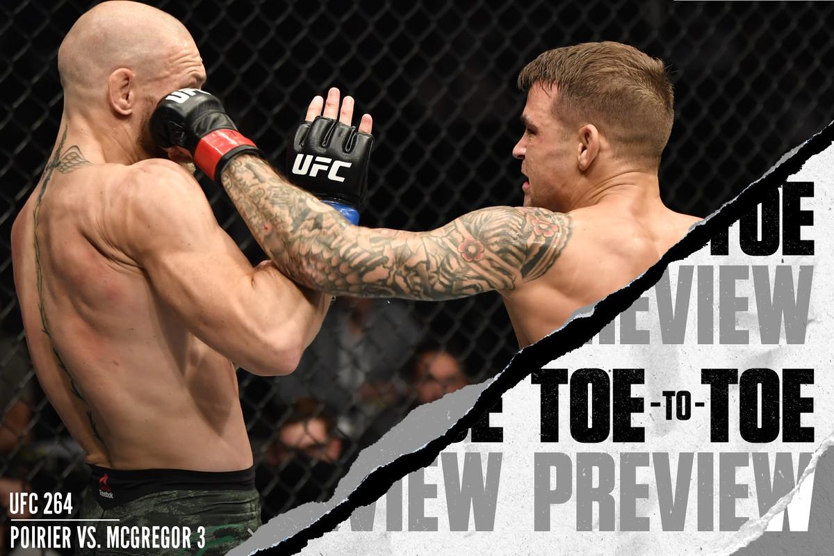 Dustin Poirier punches Conor McGregor at UFC 257.