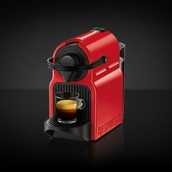 """Sometimes leaving the apartment isn't an option (maybe because she's wearing the onesie) but coffee is still crucial. The <b><a href =""""https://www.nespresso.com/us/en/order/machines/original/nespresso-c40-inissia-ruby-red-coffee-machine"""">Nespresso Inissia"""