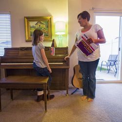 Piano teacher and stay-at-home mom Liana Sorenson works with Aedel Robertson at her home in Heber on Tuesday, Nov. 24, 2015.
