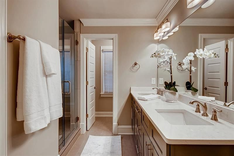 A bathroom with two vanities.