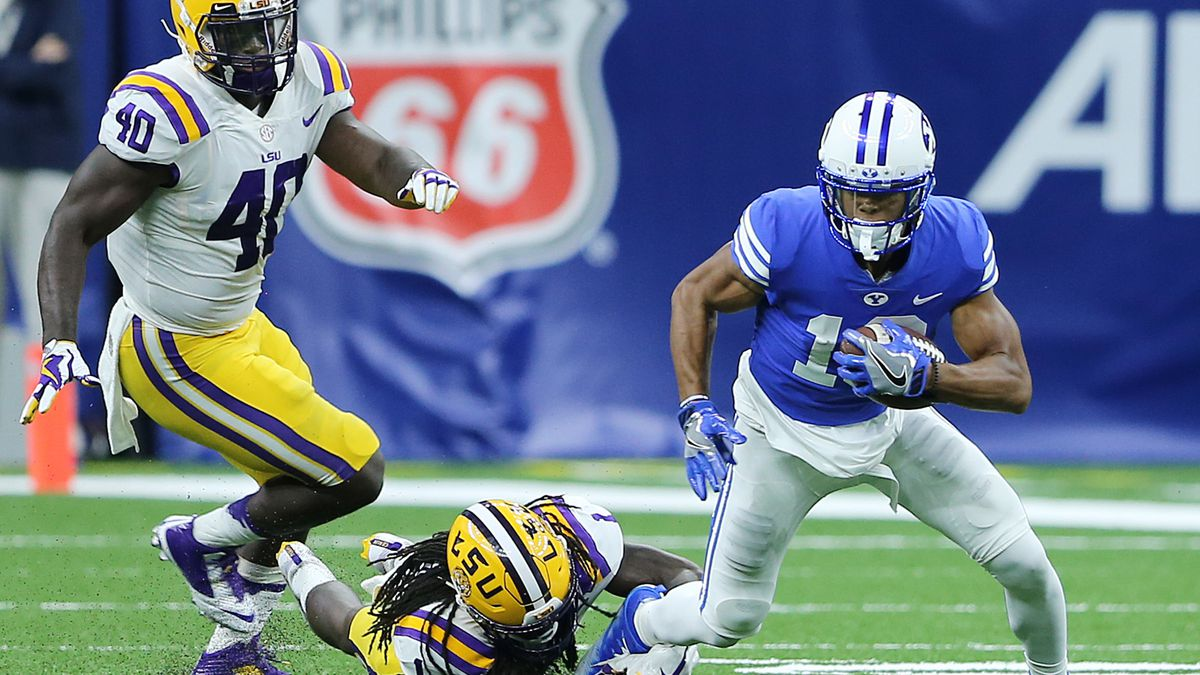 LSU Tigers defensive back Donte Jackson (1) brings down BYU wide receiver Micah Simon (13) as BYU and LSU play in the Mercedes-Benz Superdome in New Orleans on Saturday, Sept. 2, 2017.