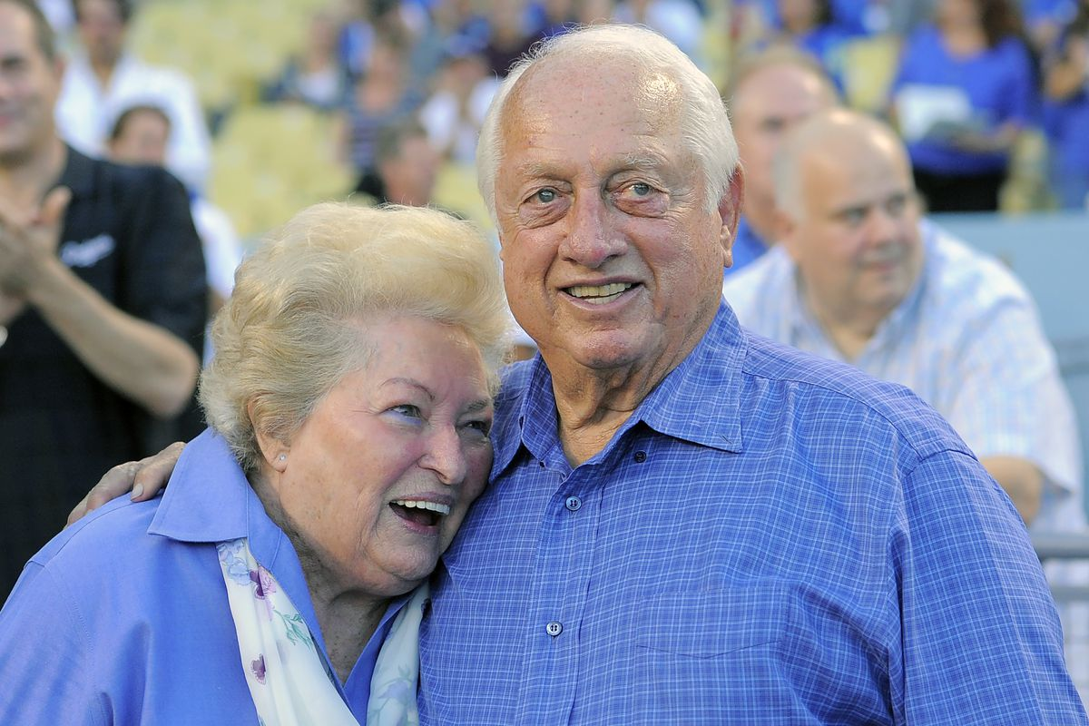 Tommy Lasorda and his wife Jo hug as they watch a video tribute to Tommy at Dodger Stadium in 2013. Jo Lasorda died Monday at age 91.