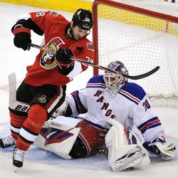 Ottawa Senators' Zenon Konopka keeps his eye on the puck as he attempts to score on New York Rangers' Henrik Lundqvist during the first period of game three of first round NHL Stanley Cup playoff hockey action at the Scotiabank Place in Ottawa on Monday, April 16, 2012. (AP Photo/The Canadian Press, Sean Kilpatrick)