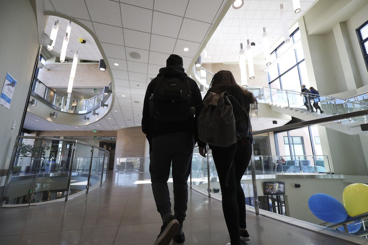 Salt Lake Community College students walks through the Academic and Administration Building on campus in Taylorsville on Tuesday, March 10, 2020. Utah colleges continue to make contingency plans in the wake of the spread of COVID-19. Some plans include moving exclusively to online classes.