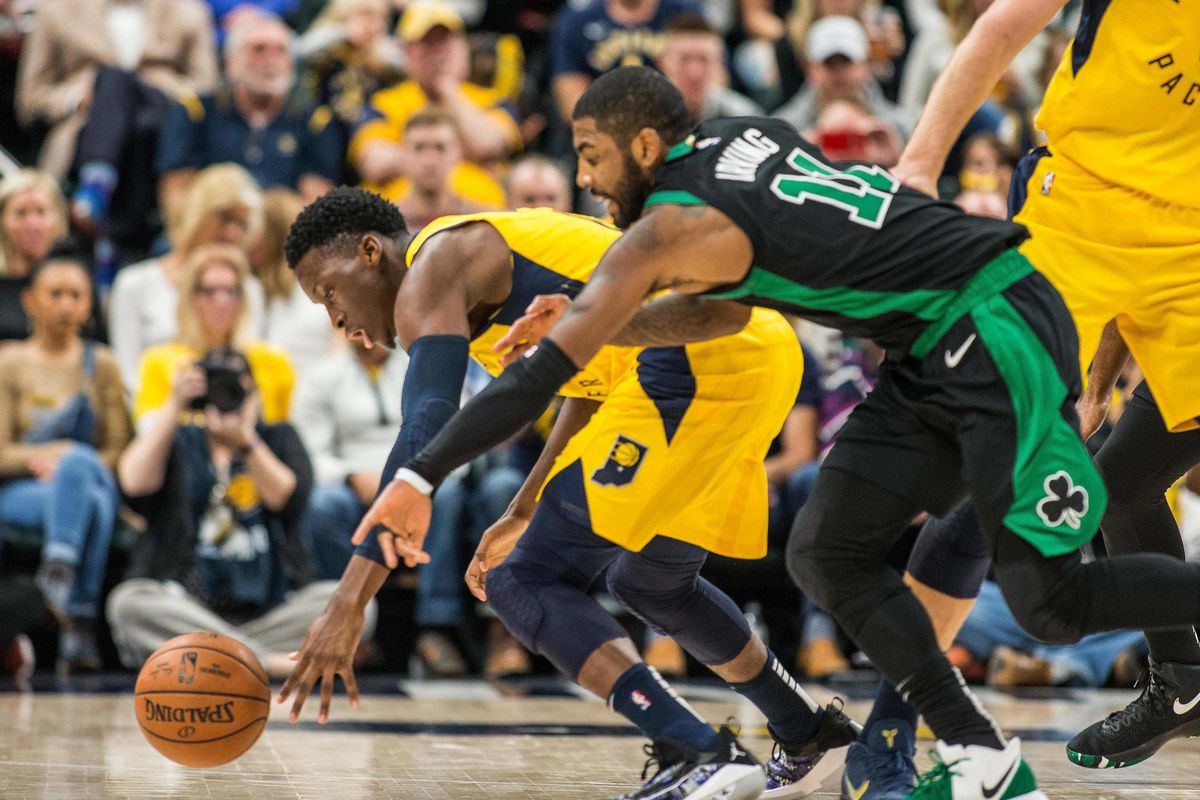 267e0b0eda2 Indiana Pacers guard Victor Oladipo (4) and Boston Celtics guard Kyrie  Irving (11) dive or a loose ball in the second half at Bankers Life  Fieldhouse.