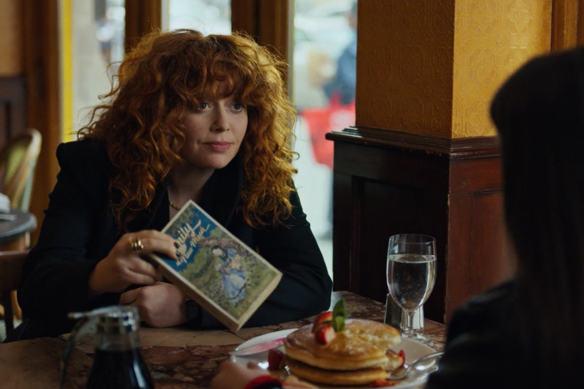 Natasha Lyonne as Nadia offers Lucy a copy of Emily of New Moon