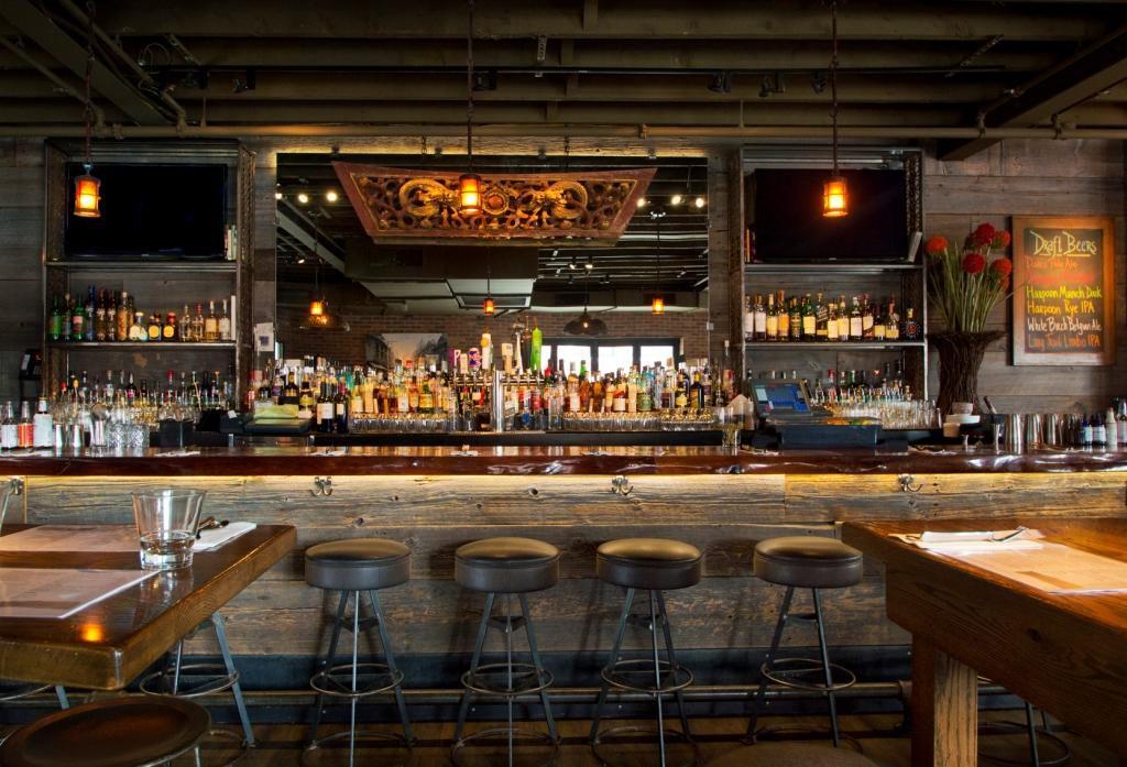 A dimly lit wooden bar at a restaurant