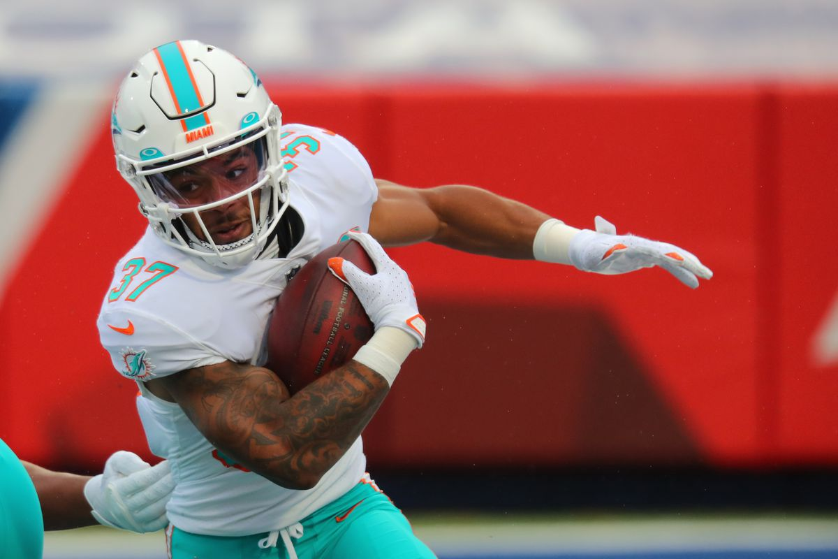 Myles Gaskin #37 of the Miami Dolphins runs the ball against the Buffalo Bills at Bills Stadium on January 3, 2021 in Orchard Park, New York.