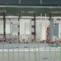 Metal cabinet boxes installed on the right-field inner wall -