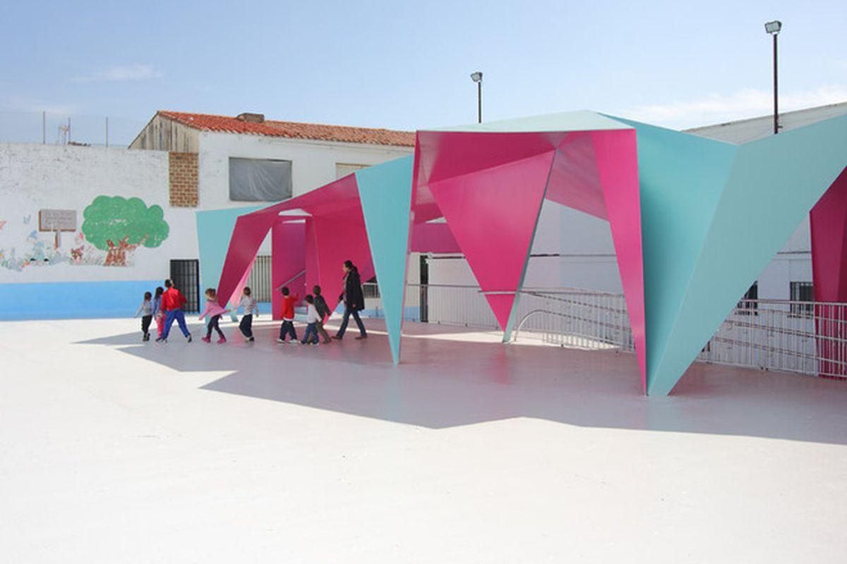 "All photos by Julio Barreno Gutiérrez via <a href=""http://www.dezeen.com/2015/06/14/julio-barreno-gutierrez-pavilion-canopy-folded-steel-awning-playground-school-algodonales-andalusia/"">Dezeen</a>"
