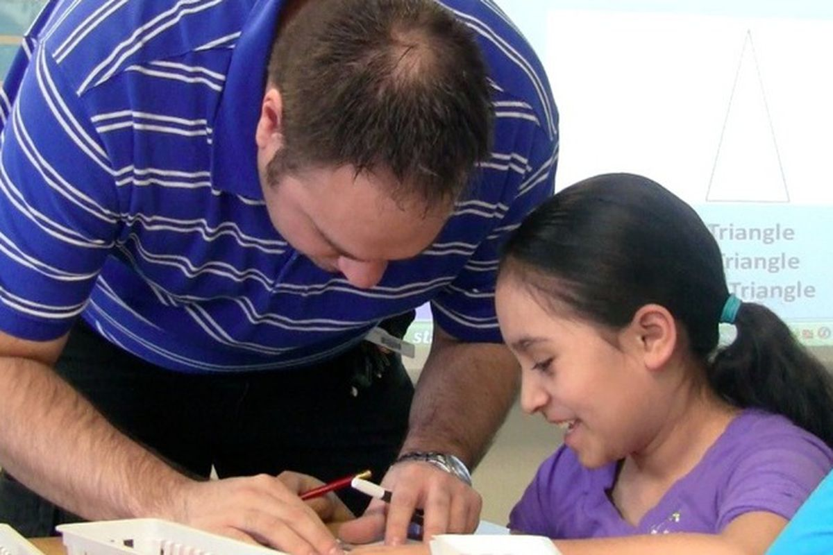 A teacher works with a student at Center's Haskin Elementary.
