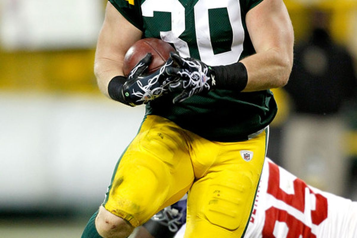 GREEN BAY WI - DECEMBER 26:  John Kuhn #30 of the Green Bay Packers carries the ball for a touchdown against the New York Giants at Lambeau Field on December 26 2010 in Green Bay Wisconsin.  (Photo by Matthew Stockman/Getty Images)