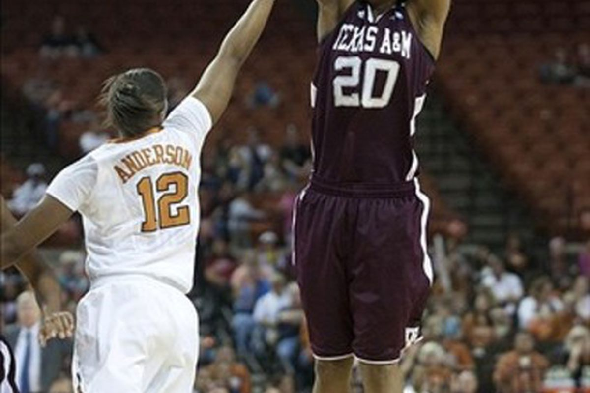 Mar 4 2012; Austin, TX, USA; Texas A&M Aggies guard Tyra White (20) shoots over Texas Longhorns guard Yvonne Anderson (12) during the first half at the Frank Erwin Center. Mandatory Credit: Brendan Maloney-US PRESSWIRE