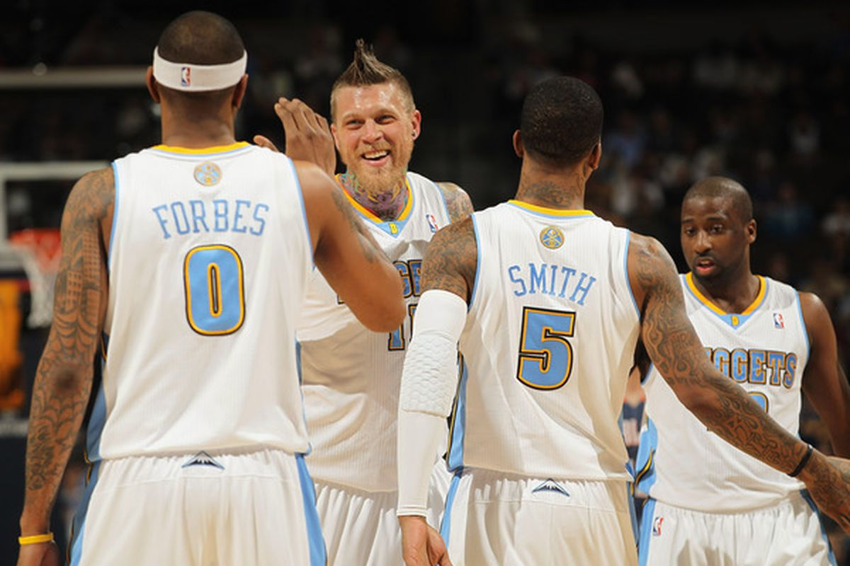 Gary Forbes #0, Chris Andersen #11, J.R. Smith #5 and Raymond Felton #20 playing the ultimate team game for the Nuggets.