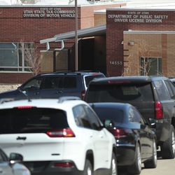 Hundreds of cars wait in lineat the Division of Motor Vehicles drive-thru window in Draper on Friday, April 3, 2020. Some waited in line for hours.