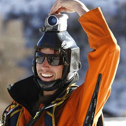 Jesse Hall, of Boulder, Colo., smiles as he turns off his head cam after jumping off the cliffs in Echo Canyon.