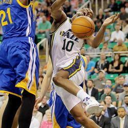 Utah's Alec Burks is fouled by Warriors' Dewayne Dedmon on a drive to the hoop as the Utah Jazz and the Golden State Warriors play Tuesday, Oct. 8, 2013 in preseason action at Energy Solutions arena in Salt Lake City.