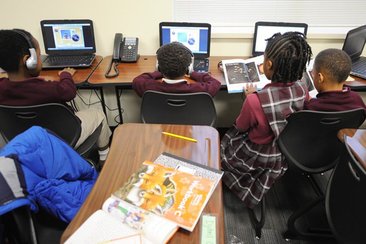 Second-graders work on computers at Tindley.