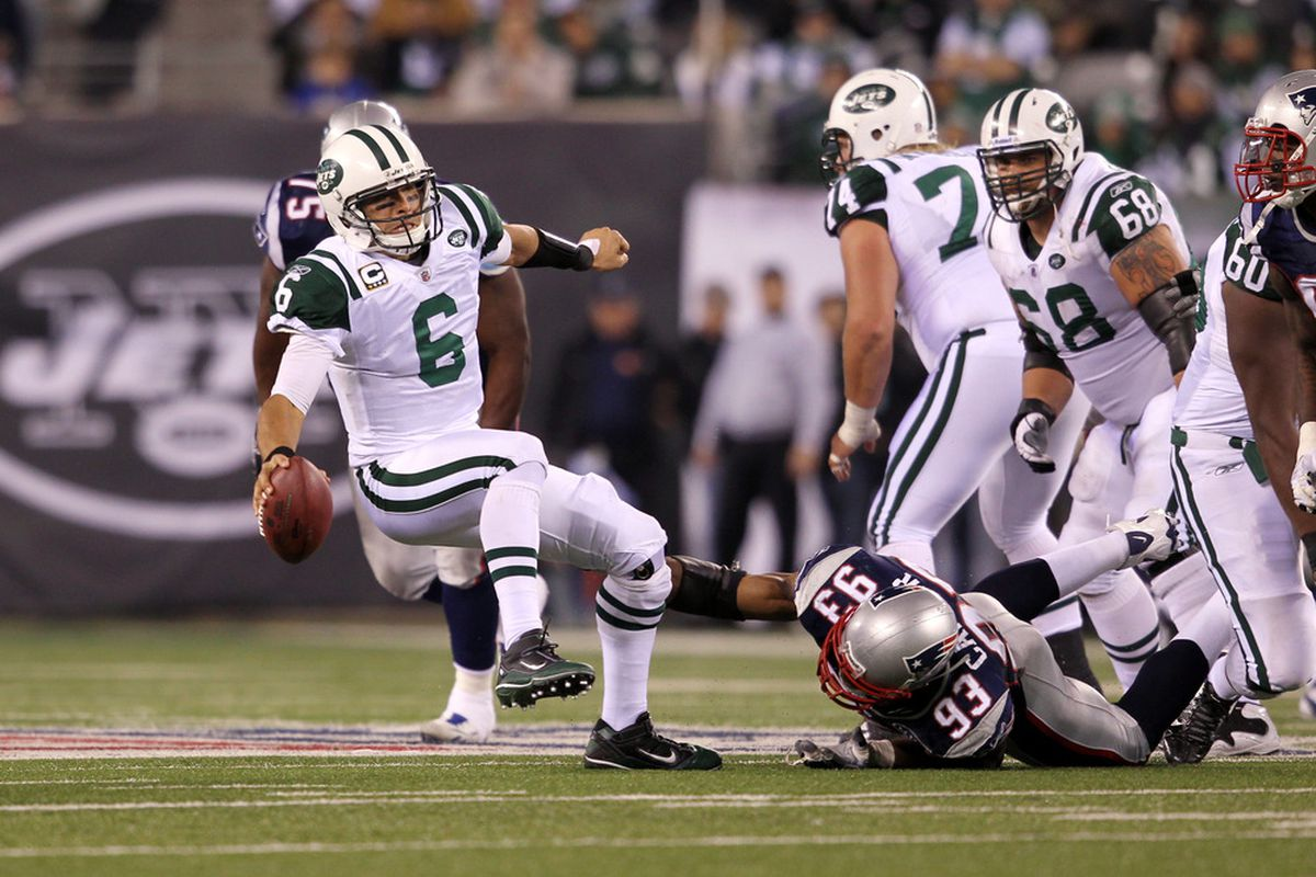 EAST RUTHERFORD, NJ - NOVEMBER 13:  Mark Sanchez #6 of the New York Jets gets sacked by  Andre Carter #93 of the New England Patriots at MetLife Stadium on November 13, 2011 in East Rutherford, New Jersey.  (Photo by Nick Laham/Getty Images)