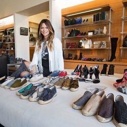 Designer Elyse Walker with her shoe designs.