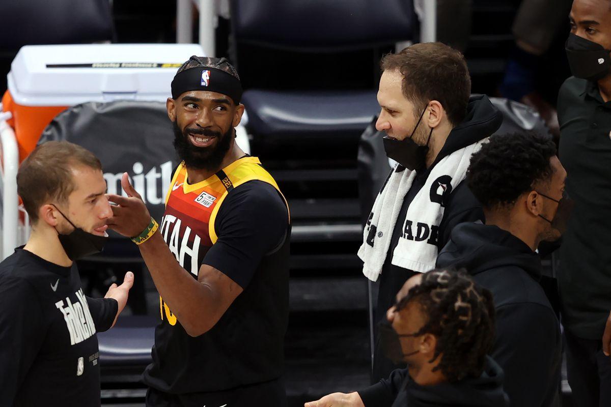 Utah Jazz guard Mike Conley smiles as he and teammate Bojan Bogdanovic talk during timeout at Vivint Arena in Salt Lake City.