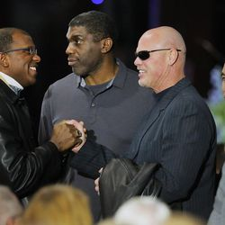 Adam Haysbert, a former BYU wide receiver, shakes, hands with former quarterback Jim McMahon as Leon White and Vai Sikahema stand nearby during a memorial for former BYU football coach LaVell Edwards at the Provo Convention Center on Friday, Jan. 6, 2017.