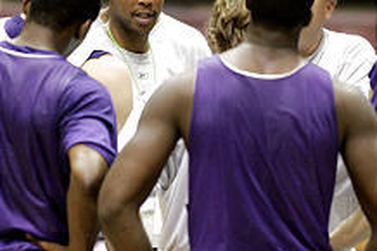 New Orleans Hornets coach Byron Scott talks with his players following practice. The Hornets season opener will be Tuesday in their temporary home in Oklahoma City.