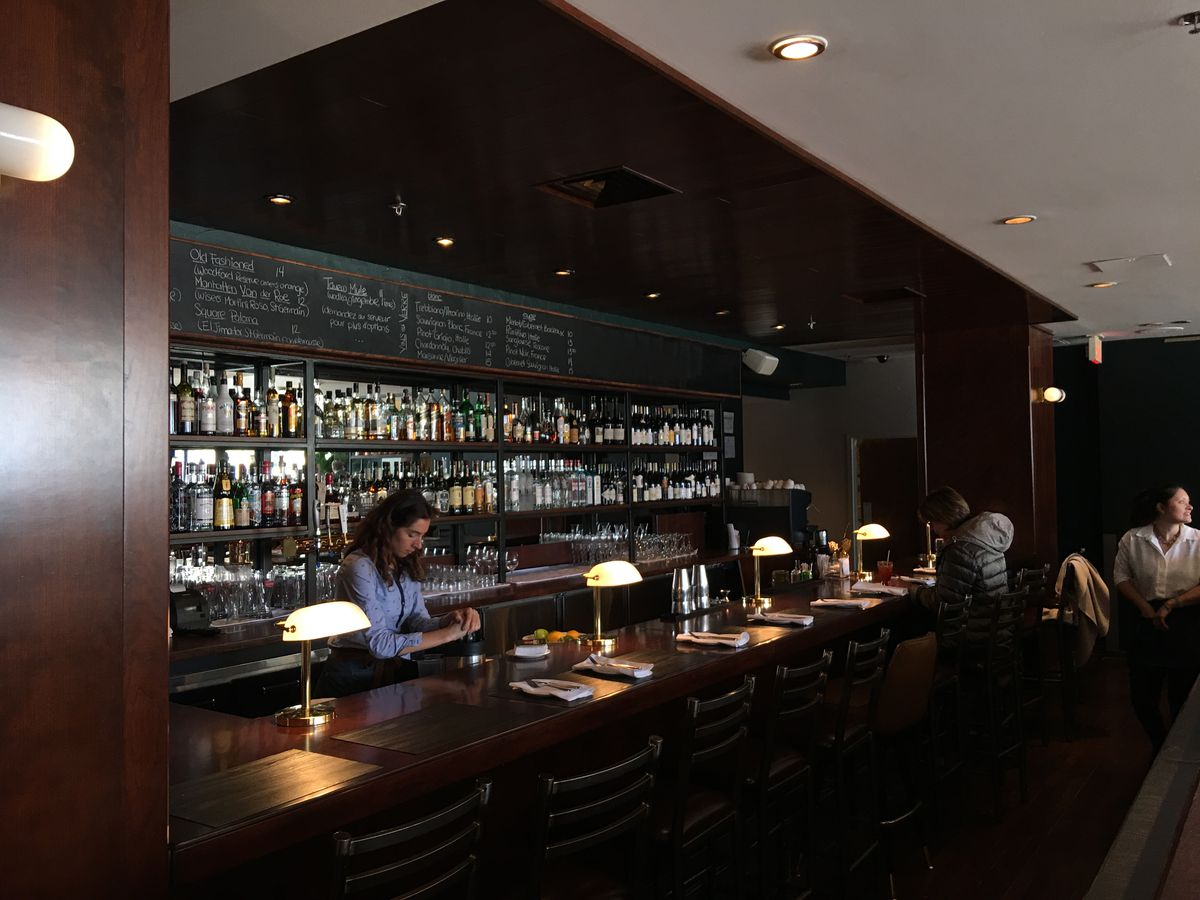 The mahogany-coloured bar at Tavern on the Square.