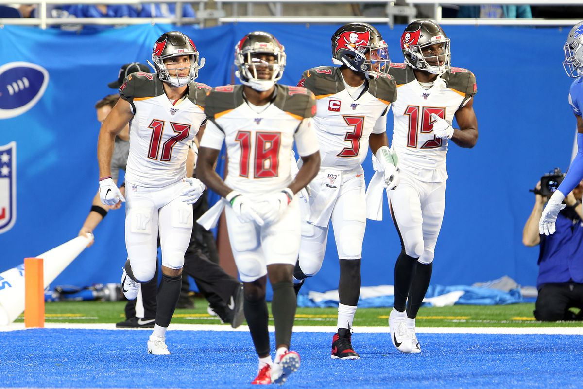 Tampa Bay Buccaneers wide receivers Justin Watson, Ishmael Hyman, and Breshad Perriman, and quarterback Jameis Winston run off the field after Perriman's touchdown during the second half of an NFL football game against the Tampa Bay Buccaneers in Detroit, Michigan USA, on Sunday, December 15, 2019.