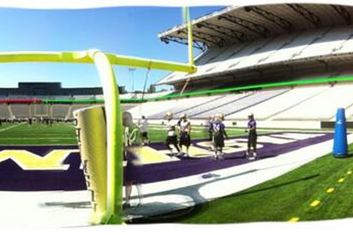 The players practiced on Day 1 right on the new Husky Stadium turf.