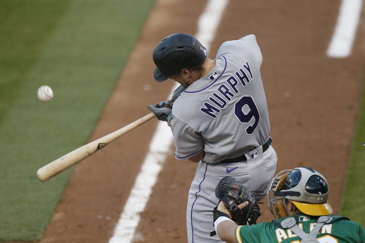 Daniel Murphy #9 of the Colorado Rockies flies out in the top of the third inning against the Oakland Athletics at Oakland-Alameda County Coliseum on July 28, 2020 in Oakland, California.