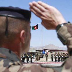 A French soldier salutes during a security transition ceremony from the French NATO forces to Afghan army in Surobi, east of Kabul, Afghanistan, Thursday, April 12 2012. The process of taking over security from around 100,000 NATO-led ISAF forces by Afghan troops should be completed by the end of 2014, when the Afghan army will take over the full leadership of its own security duties from the U.S. and NATO forces.