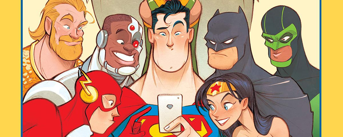 The Flash, Aquaman, Cyborg, Hawkgirl, Batman, Green Lanter/Simon Baz, and Wonder Woman crowd eagerly around Superman's smartphone on the cover of Dear Justice League, DC Comics (2019).