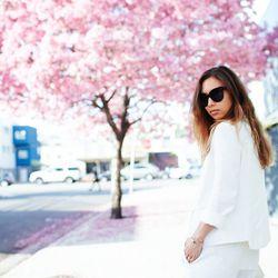 "Rumi of <a href=""http://www.fashiontoast.com/"">Fashion Toast</a> is wearing a Sandro blazer, a Theory tank top, a Zara skort, and Celine sunglasses."