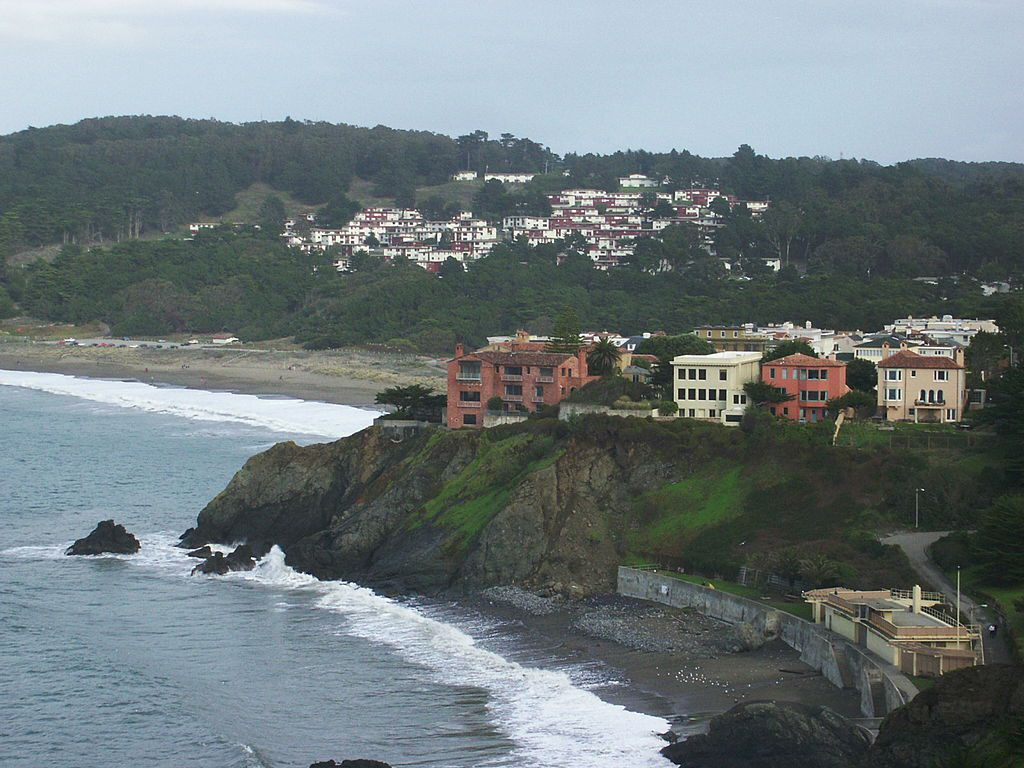 Various colorful houses on a cliff in San Francisco.