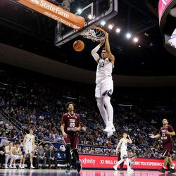 Brigham Young Cougars forward Yoeli Childs (23) dunks as BYU and Texas Southern play an NCAA basketball game in Provo at the Marriott Center on Saturday, Dec. 23, 2017. BYU won 73-52.