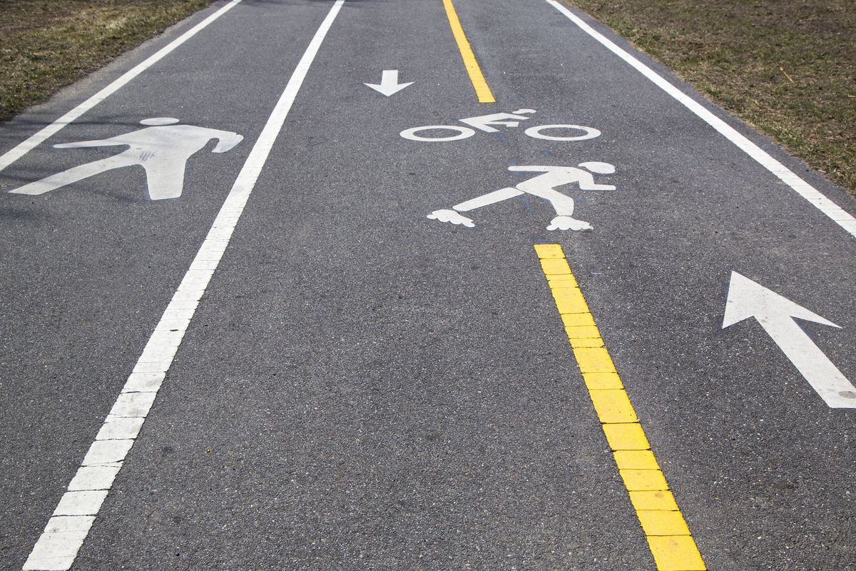 A bike lane and pedestrian path painted on a road.