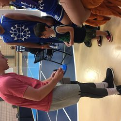 Jimmer Fredette signs an autograph for a young fan during his Jimmerosity Jam 3on3 Tournament to Stop Bullying in Provo earlier this summer.