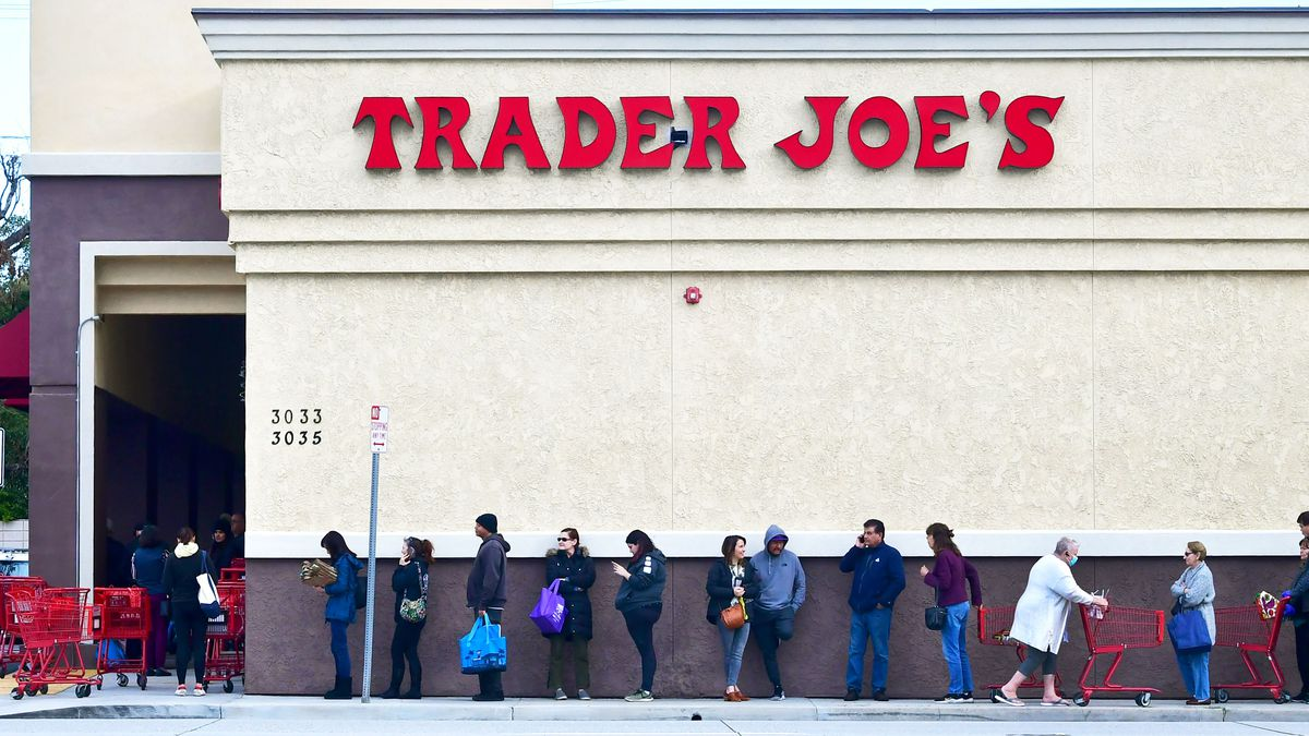 Customers lined up outside a Trader Joe's.