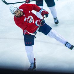 Tom Wilson takes a shot during Capitals morning skate.
